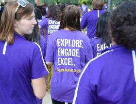 Image of student in GPS Explore Engage Excel T-Shirt